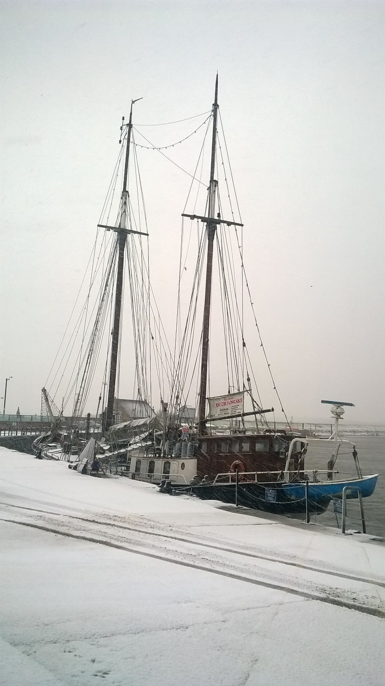 Tall ship, The Albatross in snow, snow on quay, Wells-next-the-sea harbour
