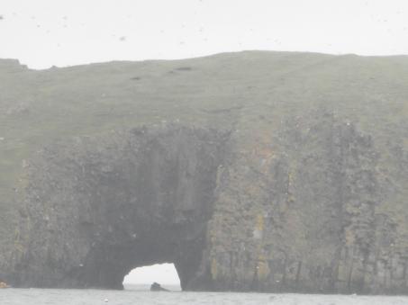 Shiant Isles, arch in basalt, in fog
