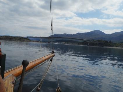 Eda Frandsen's bowsprit heading towards Skye lighthouse and road bridge