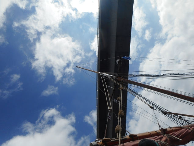 Looking up at the Skye road bridge from Eda Frandsen showing mast and boom and furled sails